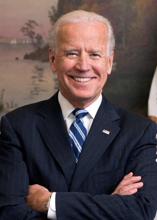 Joe Biden as seen while smiling in a picture taken in his West Wing Office at the White House in January 2013