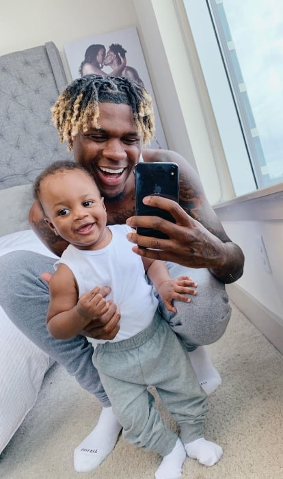 King Nique&King as seen while taking a mirror selfie with his son in May 2019