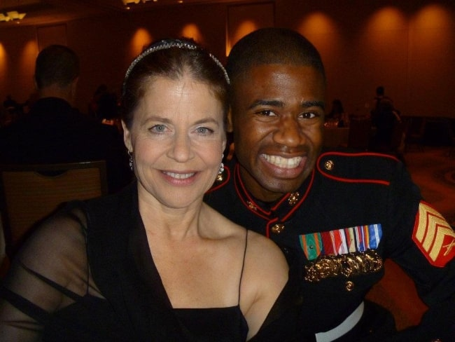 Linda Hamilton smiling in a picture alongside Marine Sgt. Raymond Lewis at the Marine Corps Birthday Ball on October 29, 2011, in Westlake, Texas, United States