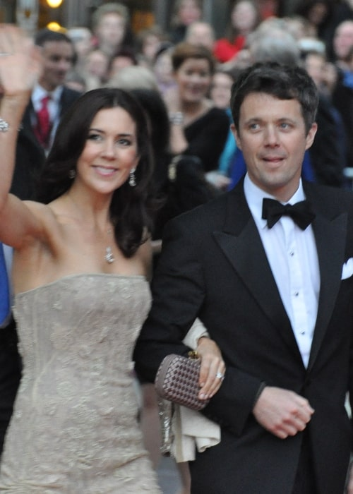 Mary, Crown Princess of Denmark, alongside Frederik, Crown Prince of Denmark, waving while arriving at the wedding of Victoria, Crown Princess of Sweden and Daniel Westling in June 2010