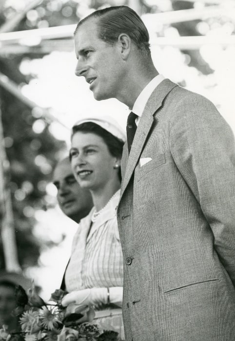Prince Philip, Duke of Edinburgh as seen in a black-and-white picture, along with Queen Elizabeth II, taken during the Royal Tour of 1953/1954 in Cambridge, Waikato, New Zealand in January 1954