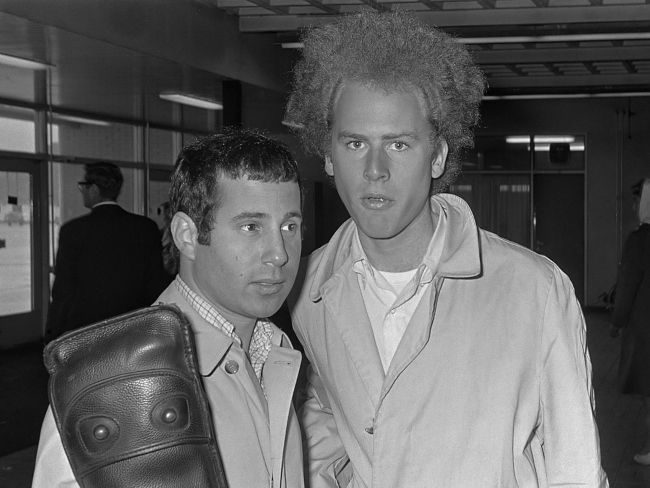 Simon (left) and Garfunkel arriving at the Schiphol Airport in the Netherlands in 1966