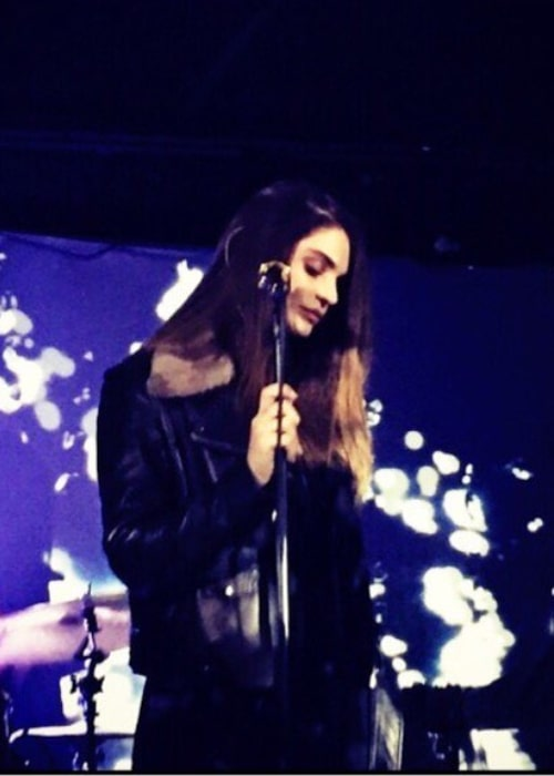 Aimee Osbourne as seen in a picture of her taken during a live performance of her in the past