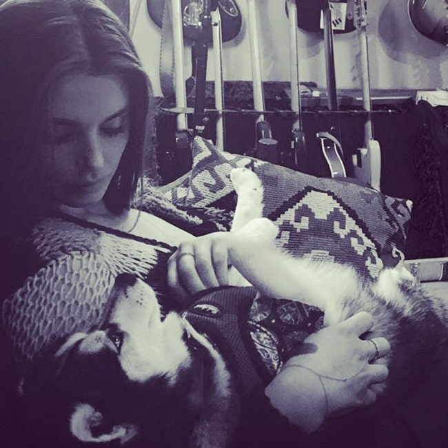 Aimee Osbourne as seen in a picture taken while she affectionately plays with a husky at Kingsize Soundlabs in December 2016