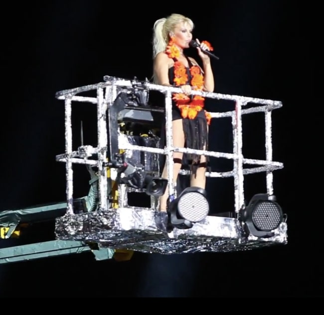 Ajda Pekkan as seen while singing on a crane machine during her concert at Kuruçeşme Arena, Istanbul in 2012