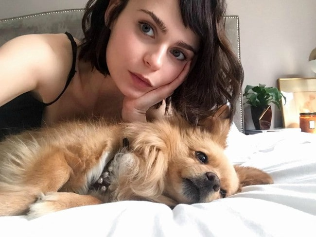 Alexandra Krosney in a selfie with her dog as seen in April 2019