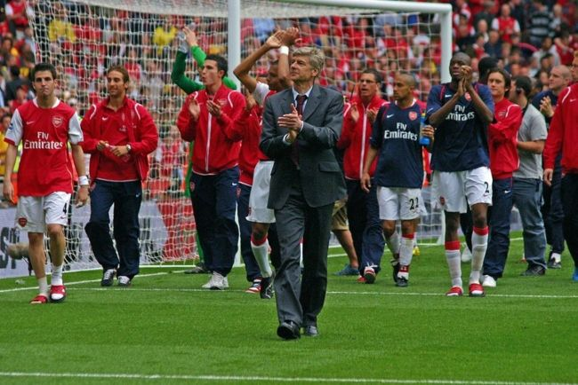 Arsène Wenger seen with Arsenal players in the background after a match in 2007