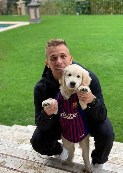 Arthur Melo with his pet dog, as seen in November 2018