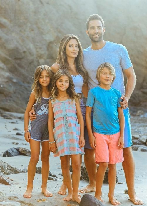 Ava Marie posing with her parents and siblings in California
