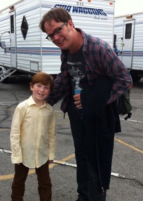 Carter Hastings as seen while smiling in a picture alongside Rainn Wilson