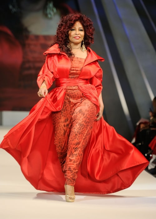 Chaka Khan walking on the runway wearing a Chris March design at The Heart Truth's Red Dress Collection 2012 Fashion Show at Hammerstein Ballroom on February 8, 2012 in New York City