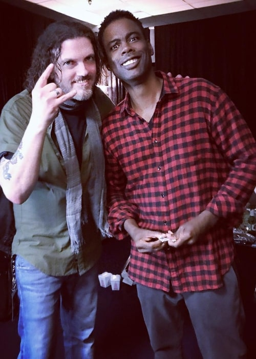Dizzy Reed (Left) posing for a picture alongside Chris Rock in October 2017