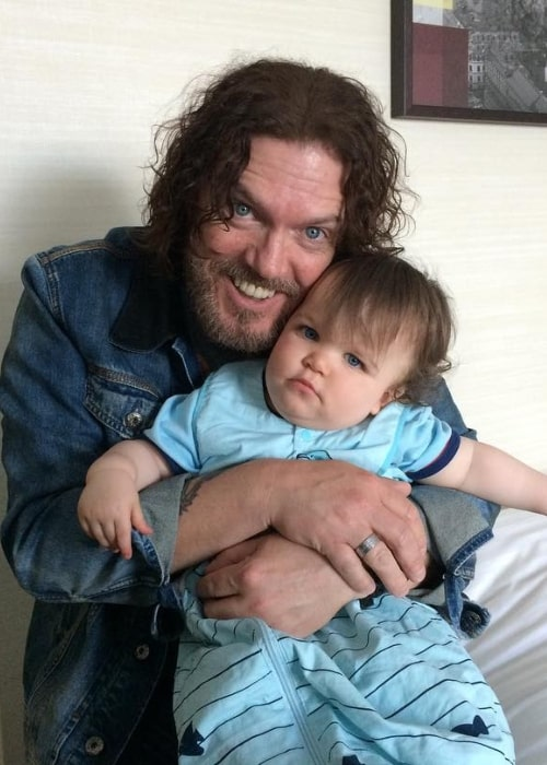 Dizzy Reed as seen while posing for a picture with his grandson Riley in June 2017
