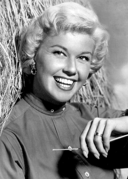 Doris Day smiling in a black-and-white picture taken in November 1957