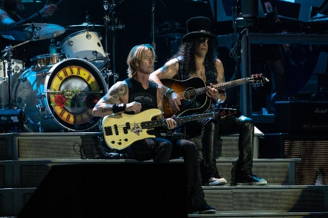 Duff McKagan (Left) and Slash performing in 2018
