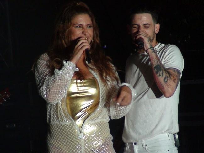 Elena Paparizou and Anastasios Rammos pictured while performing at the Ouranio Toxo Tour Live in 2018