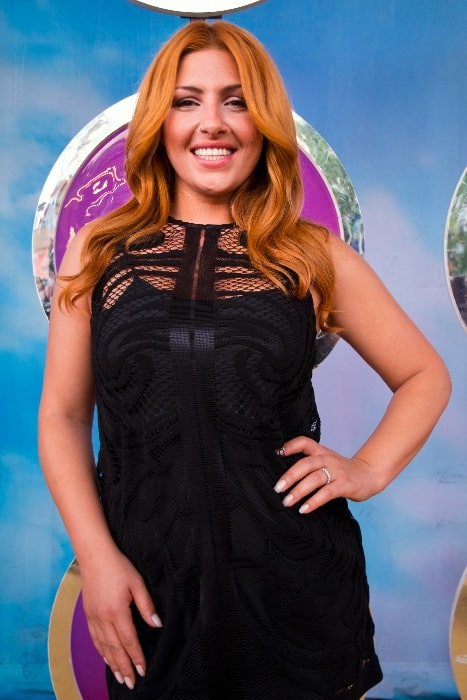 Elena Paparizou as seen while smiling for the camera in 2014