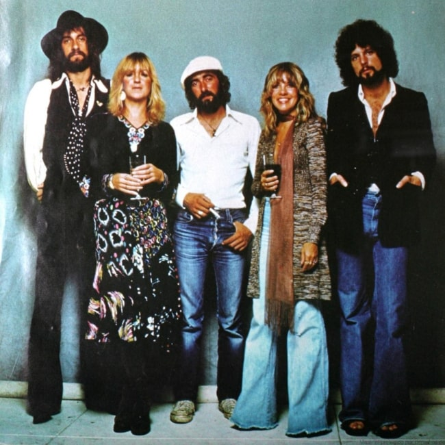 Fleetwood Mac members (From Left to Right) Mick Fleetwood, Christine McVie, John McVie, Stevie Nicks, and Lindsey Buckingham as seen in a picture taken for their album cover of Rumours
