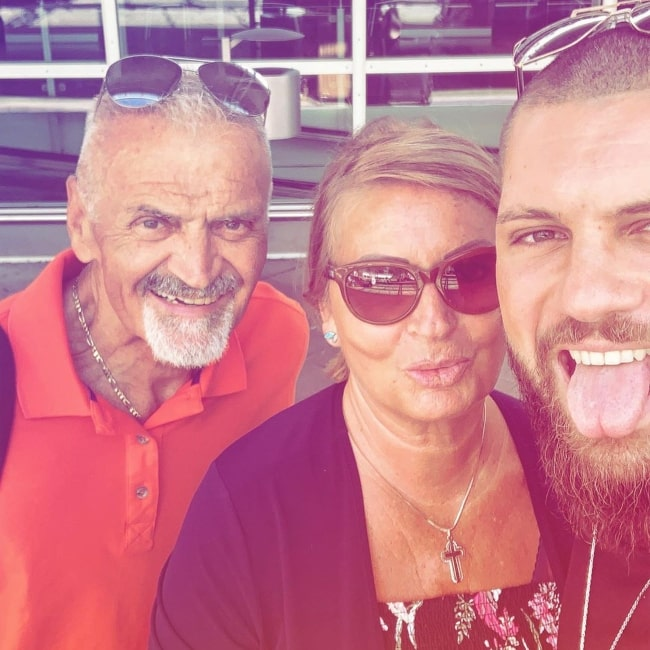 Florian Munteanu as seen in a selfie taken with his mother and father in September 2019