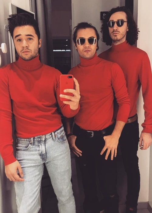 From Left to Right - Connor Montgomery, Taylor Gray, and Carneyval as seen in red turtlenecks while posing for a mirror selfie in December 2017