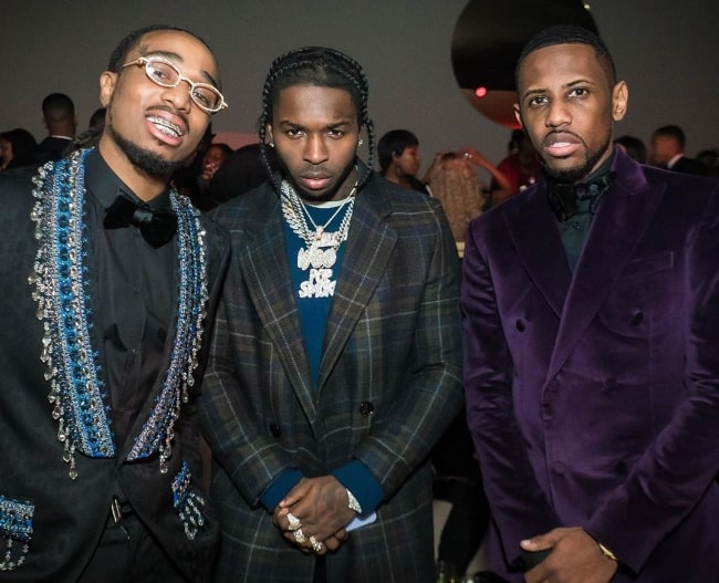 From Left to Right - Quavo Huncho, Pop Smoke, and Fabolous as seen while posing for a picture at Diddy's 50th birthday party in December 2019