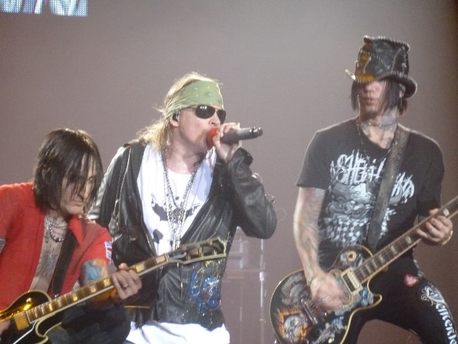 From Left to Right - Richard Fortus, Axl Rose, and DJ Ashba playing in Chile in 2011