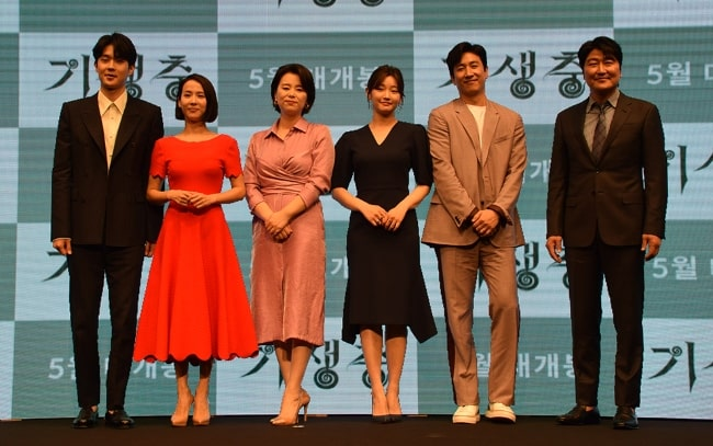 From left to right - Choi Woo-shik, Cho Yeo-jeong, Lee Jung-eun, Park So-dam, Lee Sun-kyun, and Song Kang-ho attending an event as the cast members of the film 'Parasite'