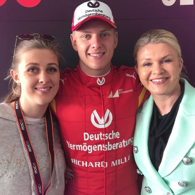 Gina Schumacher smiling in a picture along with her brother and their mother in January 2019