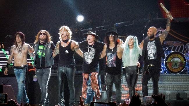 Guns N' Roses posing during an event