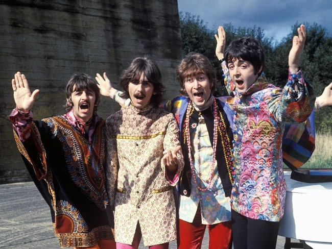 John Lennon (Third from the left) as seen in the press photo of 'The Beatles' during Magical Mystery Tour