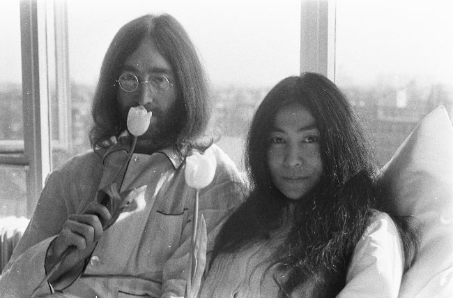 John Lennon as seen in a black-and-white picture along with Yoko Ono in March 1969