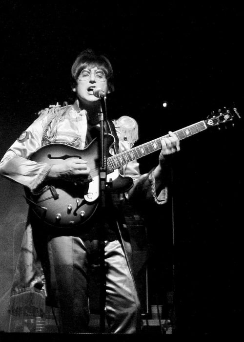 John Lennon as seen while performing during an event