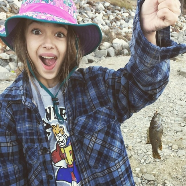 Julia Butters as seen in a picture taken after she got a fish while on a fishing trip with her father and grandfather in October 2019