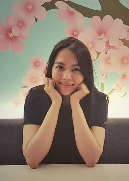 Julia Montes as seen while posing for a picture with cherry blossoms painted on the wall behind her in May 2018