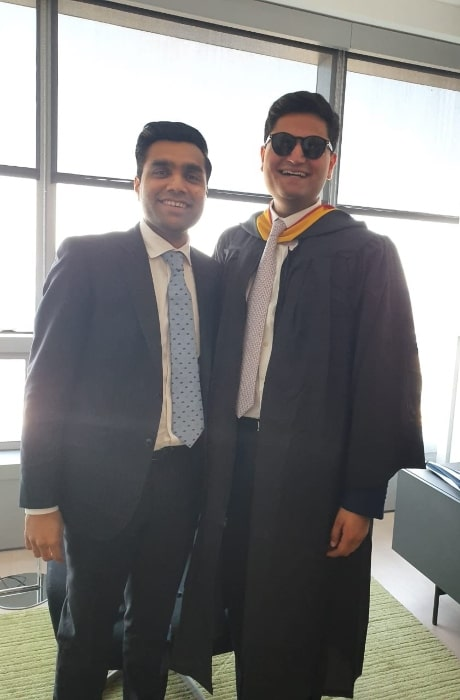 Karan Adani (Left) smiling in a picture alongside his brother, Jeet Adani, in May 2019