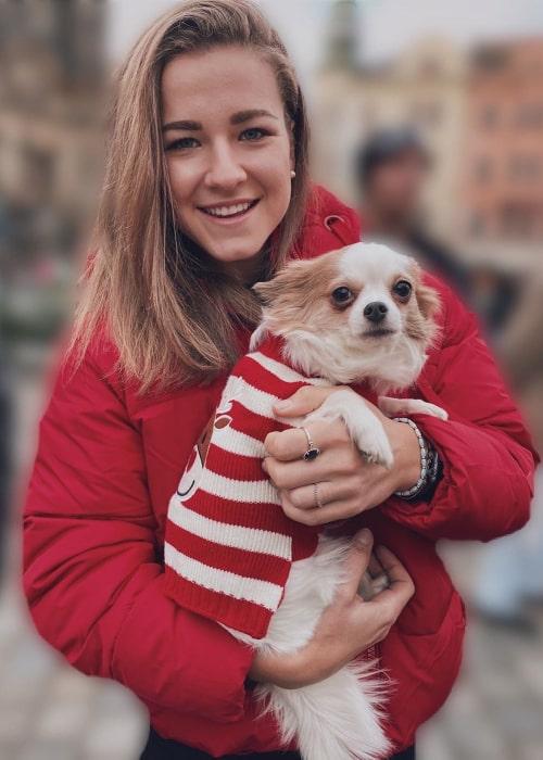 Karolína Muchová with her pet dog, as seen in December 2019