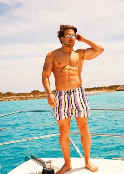 Kem Cetinay as seen in a shirtless picture taken on a boat in Ibiza May 2019