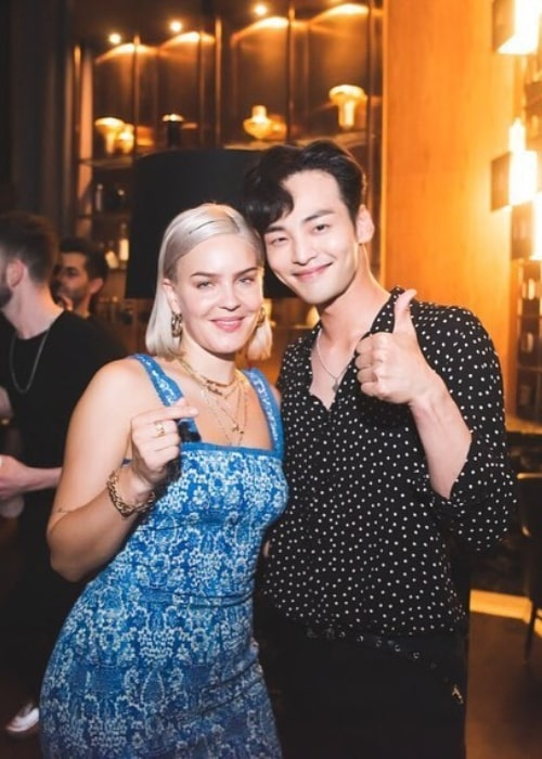 Kim Min-jae as seen while posing for a picture alongside Anne-Marie in July 2019