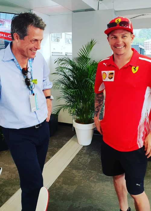Kimi Räikkönen and British actor Hugh Grant on the sidelines of the Monaco GP in May 2018