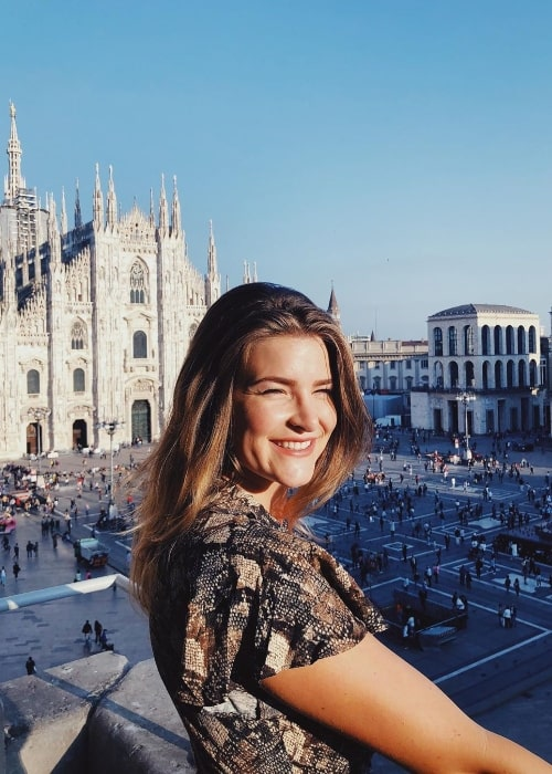 KittyPlays as seen while smiling for a picture with Milan Cathedral in the backdrop in September 2019 in Italy