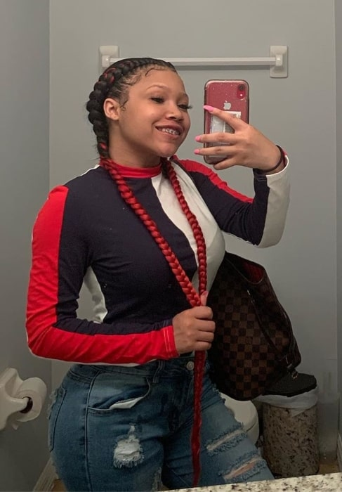 Kung-Fu as seen while taking a mirror selfie showing her braids in June 2019