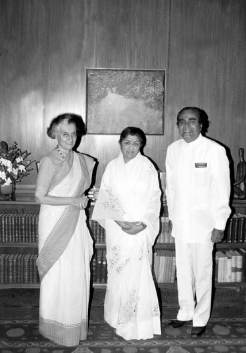 Lata Mangeshkar (Center) as seen in a picture alongside the former Prime Minister Smt. Indira Gandhi and the former Minister of State for Steel and Mines Shri N.K.P. Salve in September 1984