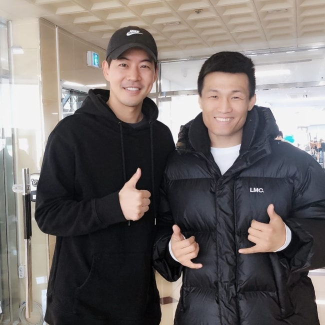 Lee Sang-yoon (Left) as seen while posing for a picture alongside Chan Sung Jung aka 'The Korean Zombie' in December 2019