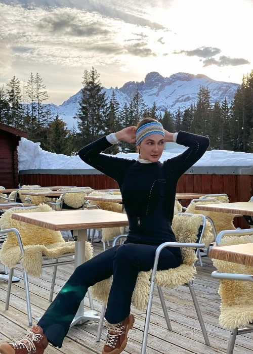 Luna Maya posing for the camera during a beautiful sunrise at Courchevel in Savoie, Rhone-Alpes, France in January 2020