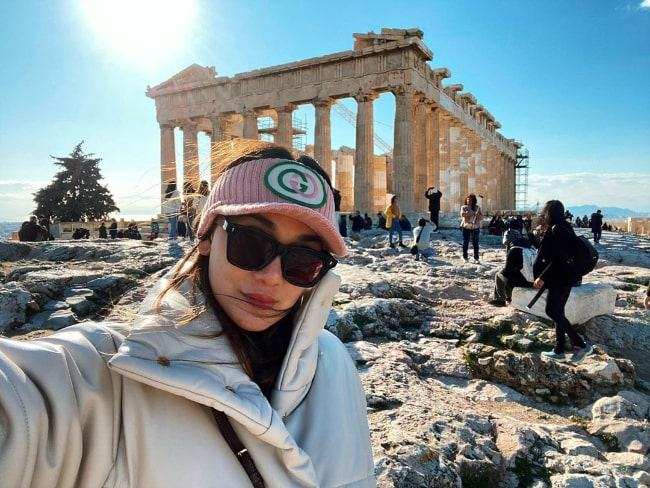 Luna Maya taking a selfie at the Acropolis of Athens in Athens, Greece in December 2019