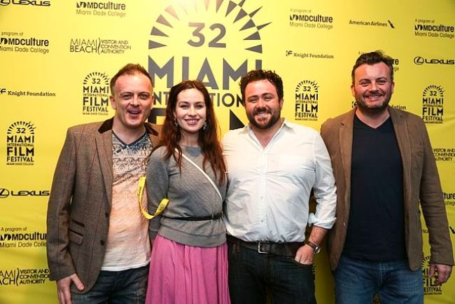 Maimie posing with director Andy Goddard (left), co-star Celyn Jones, and producer Andy Evans from her film Set Fire to the Stars