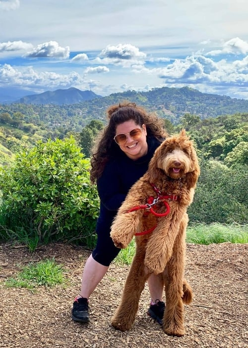 Marissa Jaret Winokur posing for a picture with her dog at Fryman Canyon Trailhead in Los Angeles, California, United States in March 2019