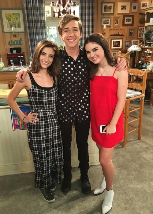 Michael Campion as seen in a picture taken on set of Fuller House with fellow co-stars Landry Bender and Soni Nicole Bringas in September 2018