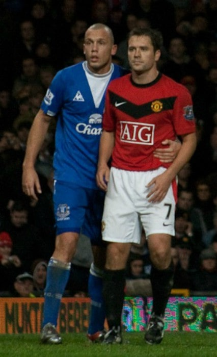 Michael Owen and Johnny Heitinga as seen in November 2009