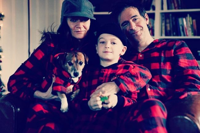 Michelle seen with husband Jack Davenport, son Harry, and their dog Frank in January 2019